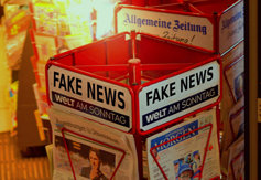"News stand with ""fake news"" written at the top"