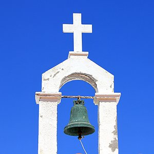 Cross and bell against the sky