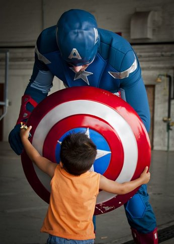 Captain America with a little boy holding his shield