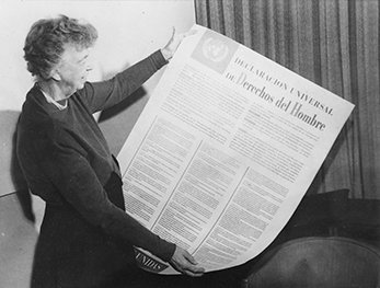 Eleanor Roosevelt holds a Spanish copy of the Universal Declaration of Human Rights