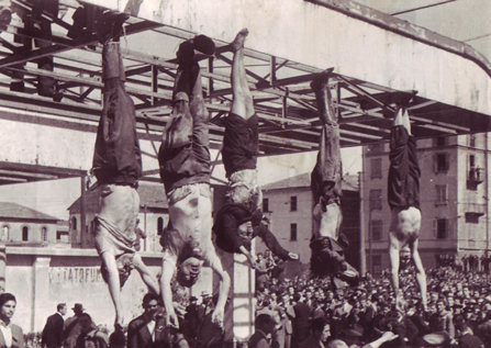 Dead bodies hanging from a metal structure