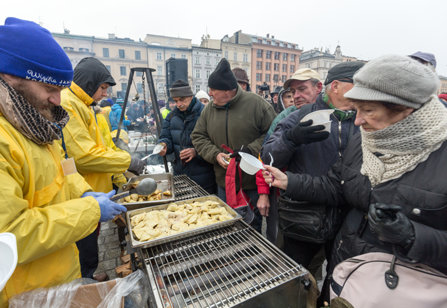 Poor and homeless being fed on Christmas Eve by volunteers