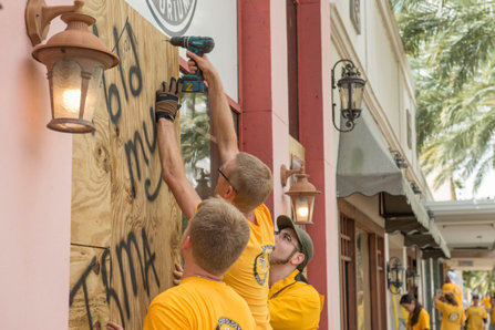 Scientology Volunteer Ministers board up stores in downtown Clearwater before Hurricane Irma