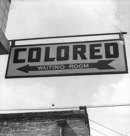 A sign reading: colored waiting room