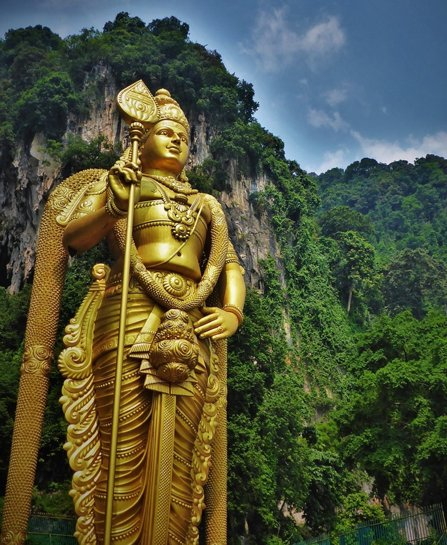 A large, gold Hindu statue in Malaysia