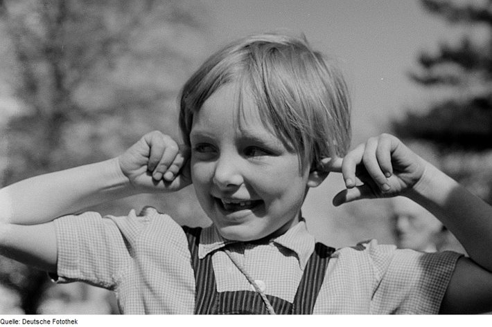 Kid with fingers in ears, not listening