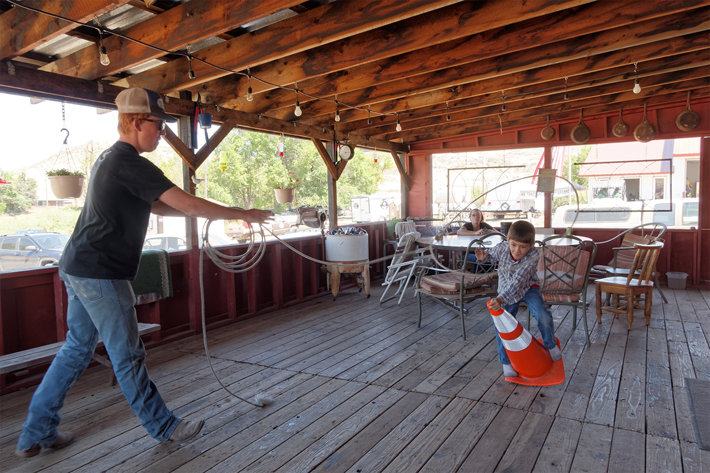 A dad and his son playing at the Ola Inn.