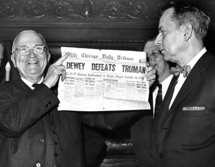 President Truman holding up newspaper declaring he had lost election he actually won