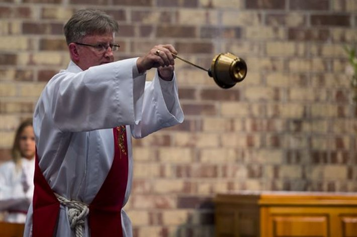Catholic bishop swings incense