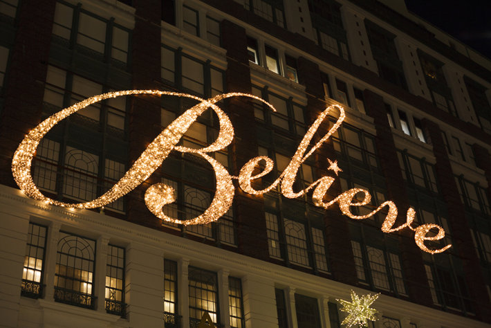 A photo of the word Believe on a building