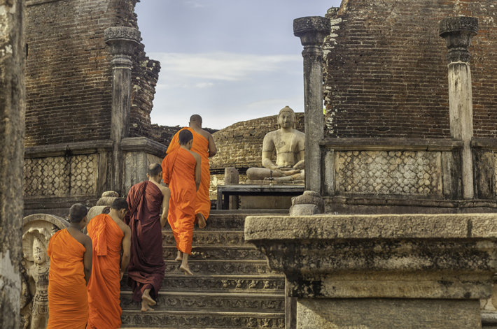 Buddhist monks walking in the famous Vatadage Temple in Polonnaruwa