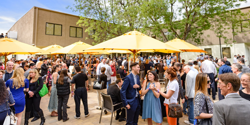 Guests gathering in the outdoor cafe after the grand opening of the Church of Scientology of the Valley