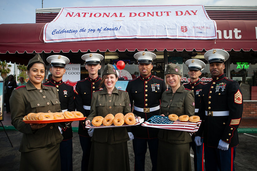 Salvation Army members offer platters of donuts for National Donut Day