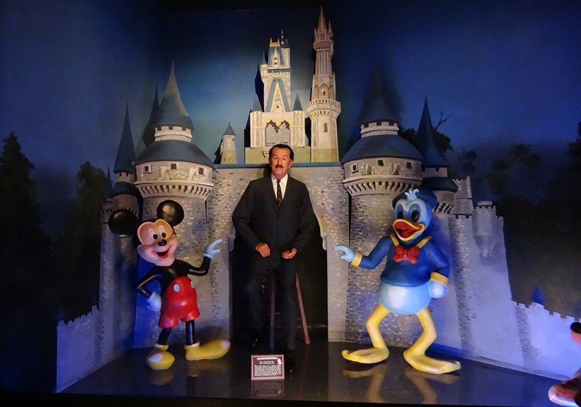 A representation of Walt Disney with Disney characters
