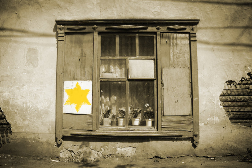 A yellow star on a building