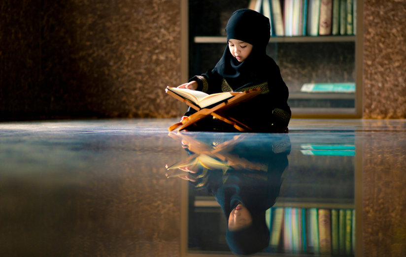 Little Muslim girl reading
