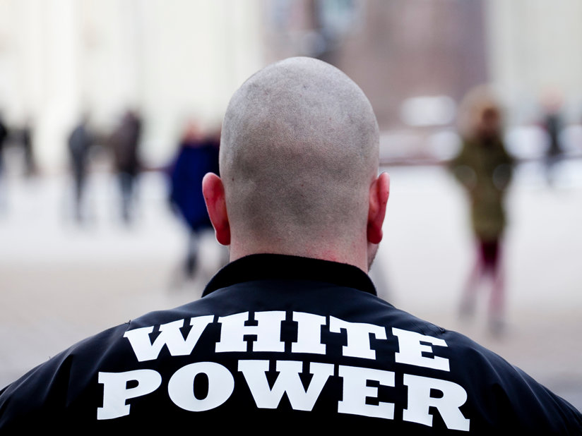 A man with a White Power jacket