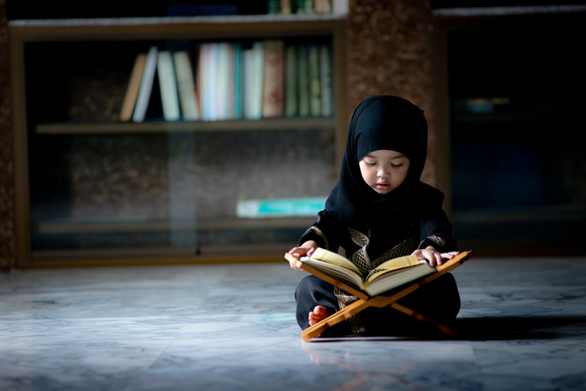 Muslim girl reading a book